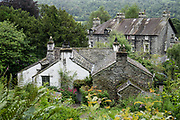 In Dove Cottage in the heart of the remote Lake District, William Wordsworth (1770–1850) wrote some of the greatest poetry in the English language and his sister Dorothy kept her 'Grasmere Journal', displayed in the Museum. Visit Dove cottage in Grasmere, Cumbria county, England, United Kingdom, Europe. England Coast to Coast hike day 5 of 14: Grasmere to Ullswater. [This image, commissioned by Wilderness Travel, is not available to any other agency providing group travel in the UK, but may otherwise be licensable from Tom Dempsey – please inquire at PhotoSeek.com.]