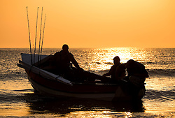 © Licensed to London News Pictures.02/07/15<br /> Saltburn by the Sea, UK. <br /> <br /> The crew of the fishing boat, Alice, prepare to head out at dawn from the beach at Saltburn for a day's fishing.<br /> <br /> Photo credit : Ian Forsyth/LNP