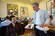 Malmö. Salt & Brygga restaurant serves manly local organic food. Mastermind Björn Stenbeck serving Trio made of Valrhona organic fair trade chocolate (l.), Crème Brûlée with rhubarb sorbet.