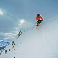 A backcountry skier jumps off Henderson Mountain near Cooke City, Montana.