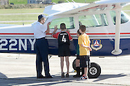 Montgomery, New York - A female member of the Civil Air Patrol's Cadet Program shows three boys a Civil Air Patrol airplane at Orange County Airport on Oct. 2, 2010.