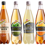 Schweppes Beauty Bottles range on a white background. Ginger Beer, Apple Pear & Cinnamon, Cloudy Lemonade, Grapefruit & Mandarin Ray Massey is an established, award winning, UK professional  photographer, shooting creative advertising and editorial images from his stunning studio in a converted church in Camden Town, London NW1. Ray Massey specialises in drinks and liquids, still life and hands, product, gymnastics, special effects (sfx) and location photography. He is particularly known for dynamic high speed action shots of pours, bubbles, splashes and explosions in beers, champagnes, sodas, cocktails and beverages of all descriptions, as well as perfumes, paint, ink, water – even ice! Ray Massey works throughout the world with advertising agencies, designers, design groups, PR companies and directly with clients. He regularly manages the entire creative process, including post-production composition, manipulation and retouching, working with his team of retouchers to produce final images ready for publication.