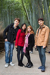Japanese tourists in a bamboo forest, Kyoto, Japan. December 10, 2015.  Photography ©2015 Michael Lichter.