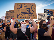 29 MAY 2020 - DES MOINES, IOWA: Black Lives Matter supporters picket the Des Moines Police station after a vigil for George Floyd in Des Moines Friday evening. About 1,000 people attended the vigil. Floyd, a 46 year old unarmed African-American man, was killed by four Minneapolis police officers Monday evening May 25. The four police officers were fired from the Minneapolis Police Department. Officer Derek Chauvin, seen in videos with his knee on Floyd's neck, was charged with third-degree murder and second-degree manslaughter on Friday in Floyd's death. The death of George Floyd, while he was restrained and in police custody, has set off protests and vigils across the US.        PHOTO BY JACK KURTZ
