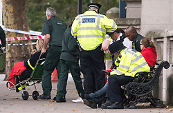 © Licensed to London News Pictures. 07/10/2017. London, UK.  Injured people being treated at the scene of an incident outside the Natural History Museum. Early reports say a man has been arrested after pedestrians were injured in a collision with a car. Photo credit: Ben Cawthra/LNP