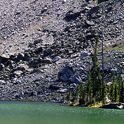 Dissolved minerals in the alpine lakes of the Wind River Range, Wyoming turn the waters of Native Lake green.