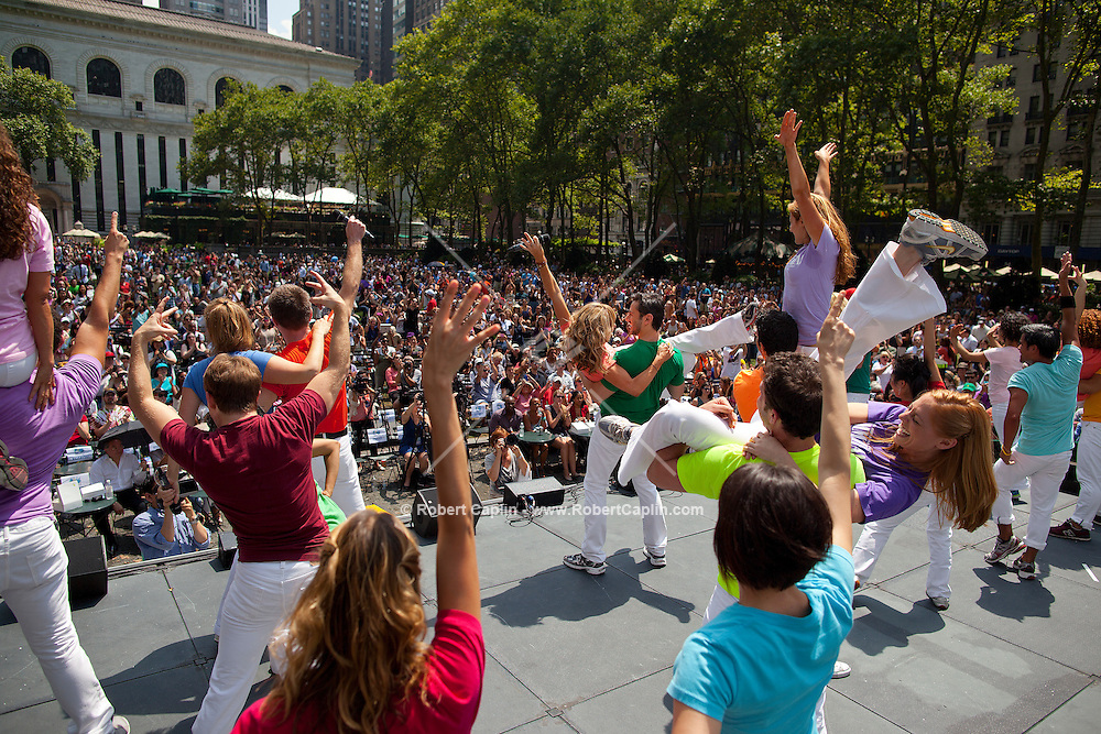 The cast of Mamma Mia! performs in Bryant Park in New York. .. Photo by Robert Caplin