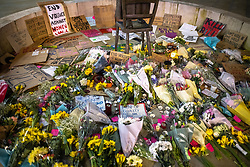 """© Licensed to London News Pictures. 20/03/2021. Manchester, UK. People leave flowers and placards around a statue of Emmeline Pankhurst in the square . A """" Kill the Bill """" and Reclaim the Streets protest demonstration is held in St Peter's Square in Manchester City Centre in opposition to the Police, Crime, Sentencing and Courts Bill 2021 that is currently before Parliament and after the death of Sarah Everard in London . Photo credit: Joel Goodman/LNP"""