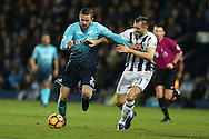 Gylfi Sigurdsson of Swansea city  holds off Gareth McAuley of West Bromwich Albion. Premier league match, West Bromwich Albion v Swansea city at the Hawthorns stadium in West Bromwich, Midlands on Wednesday 14th December 2016. pic by Andrew Orchard, Andrew Orchard sports photography.