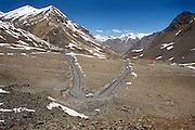 Solitary cars travel on the Leh-Manali Highway.