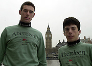 © Peter Spurrier / Intersport images<br /> email images@Intersport-images.com -  <br /> 2003 - Rowing - 149th Varsity Boat Race - Weigh-in<br /> 01/04/03<br /> Cambridge Blue Boat<br /> Hugo Mallinson, left and  cox  Jim Omartian
