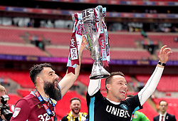 Aston Villa's Mile Jedinak (left) and John Terry celebrate with the trophy at the end of the Sky Bet Championship Play-off final at Wembley Stadium, London.