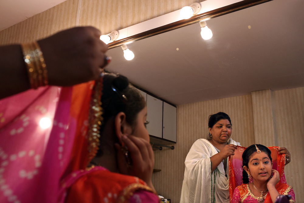 """Avika, 12, is prepared for her role as the young bride Anandi in Balika Vadhu, a television show currently being broadcast on Colors TV, Rajasthan, India, April 21, 2009. Assisting her in the dressing room is stylist Razia. The serial is set up in rural Rajasthan and deals with the practice of child marriage, a social custom still prevalent in parts of India. Rahul Chhabra, spokesman for the Indian Embassy in Washington, says his government """"is aware of the problem and trying to do its best,"""" imposing jail terms and fines, even for those attending weddings of underage brides."""