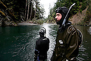 Fish biologist Christian Torgersen (USGS) shows his fatigue during a snorkel survey of the Elwha River, in Olympic National Park, Washington. The research is a collaborative effort between the National Park Service and other agencies to establish a baseline of fish distribution and habitat structure for the entire river before the removal of the upper and lower dams scheduled for 2012.