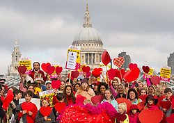 Lily Cole (centre) joins the Love In Action Have a Heart gathering at the Millennium Bridge in London, calling for the Government to help child refugees displaced by the demolition of the Jungle refugee camp in Calais.