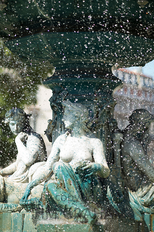 Magnificent Baroque fountain in Rossio Square - King Pedro IV Square - surrounded by traditional architecture in the City of Lisbon, Portugal