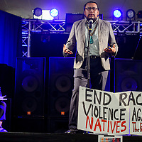 Brandon Benallie takes a turn at the microphone during a public forum on racial profiling at the Gallup Downtown Conference Center Tuesday.