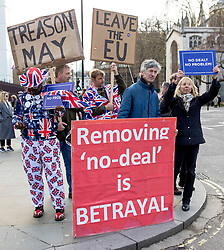 """© Licensed to London News Pictures. 13/03/2019. London, UK. Pro-Brexit protesters demonstrating outside Parliament. MPs will vote on whether to remove the option of a """"no deal"""" departure from the EU today, after Prine Minister Theresa May's proposed deal was defeated for a second time last night. Photo credit: Rob Pinney/LNP"""