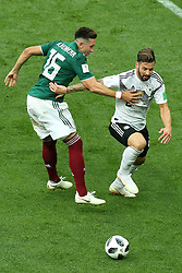 June 17, 2018 - Moscow, Russia - June 17, 2018, Russia, Moscow, FIFA World Cup, First round, Group F, Germany vs Mexico at the Luzhniki stadium. Player of the national team Marvin Plattenhardt, Hctor Miguel Herrera Lpez (Credit Image: © Russian Look via ZUMA Wire)