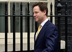 © Licensed to London News Pictures. 20/03/2013. Westminster, UK. Nick Clegg, Liberal Democrat MP, Deputy Prime Minister, ..Chancellor Of The Exchequer George Osborne poses for photographers whilst holding his red ministerial box outside 11 Downing Street In London, before presenting his annual budget to parliament today 19th March 2013. Photo credit : Stephen Simpson/LNP