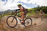Ester Suss and Sally Bigham of team Meerendal cross a river during stage 3 of the 2014 Absa Cape Epic Mountain Bike stage race held from Arabella Wines in Robertson to The Oaks Estate in Greyton, South Africa on the 26 March 2014<br /> <br /> Photo by Greg Beadle/Cape Epic/SPORTZPICS