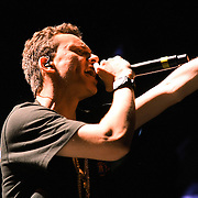Rap artist Logic performs during the Verge Campus Spring Tour concert at the CFE Arena on the University of Central Florida campus, Tuesday, April 8, 2014, in Orlando, Florida.  (AP Photo/Alex Menendez)