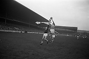 17/03/1965<br /> 03/17/1965<br /> 17 March 1965<br /> Railway Cup Football final Ulster v Connacht at Croke Park, Dublin. B. Brady, Ulster full back (right) jumps high to gather the ball near his own goalmouth, with Connacht full forward S. Cleary on left.