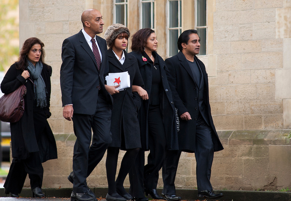 From front left to right - shekhar bhatia (dad)journalist Chameli Bhatia, Meera Syal (mum) and Sanjeev Bhaskar(step father) arriving at Snaresbrook Crown Court in East London on November 1st 2011...The teenage daughter of actress Meera Syal thrust a glass into a male model's face, leaving him scarred for life, a court heard yesterday...Chameli Bhatia, 19, allegedly attacked Christian Pannell at a birthday party of friends from the private school they both attended....