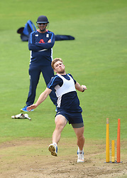 England head coach Trevor Bayliss looks on as David Willey bowls during the nets session at Cardiff Wales Stadium.