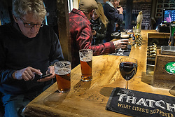 Customers drinking in a traditional English pub in Essex.