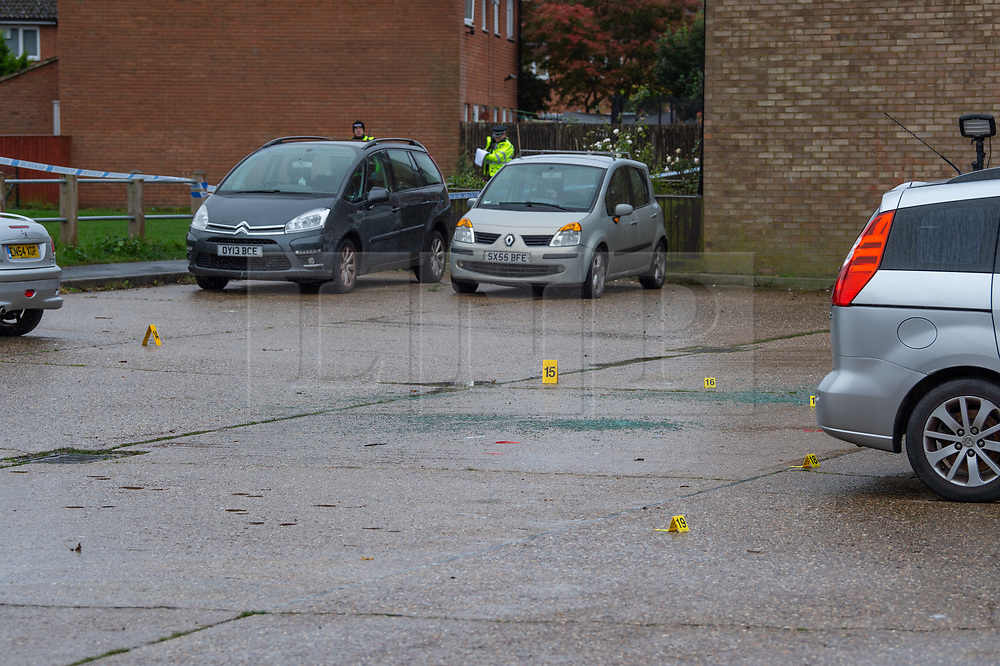 © Licensed to London News Pictures. 29/10/2020. Aylesbury, UK. Police evidence identification markers inside the cordoned crime scene. Thames Valley Police have launched a murder investigation following an incident in Aylesbury. At approximately 21:30GMT on Wednesday 28/10/2020 police officers were called to Lembrook Walk, Aylesbury not far from the Edinburgh Playing Fields following reports that two men had been assaulted. A man in his twenties was taken to hospital with serious injuries where he later died. Photo credit: Peter Manning/LNP