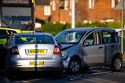 © Licensed to London News Pictures. 26/05/2021. Wythenshawe, UK. The wreckage of a motorbike is seen sandwiched between two cars at the scene of an RTA on Hollyhedge Road in Benchill , South Manchester . The road is closed to all traffic and trams . Photo credit: Joel Goodman/LNP