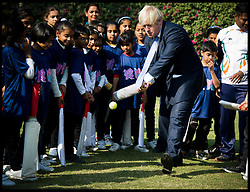London Mayor Boris Johnson plays cricket with school children in Delhi today after he handed over the London 2012 Olympic cauldron petals to Indian Olympians. The petals which were part of the Thomas Heatherwick designed cauldron which burnt throughout the Olympic and Paralympic Games will be given to every competing nation, on the second day of a six-day tour of India, where he will be trying to persuade Indian businesses to invest in London, Monday November 26, 2012. Photo by Andrew Parsons / i-Images