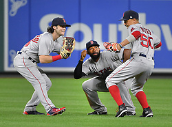 September 20, 2017 - Baltimore, MD, USA - From left, Boston Red Sox outfielders Andrew Benintendi, Jackie Bradley and Mookie Betts celebrate a 9-0 win against the Baltimore Orioles at Oriole Park at Camden Yards in Baltimore on Wednesday, Sept. 20, 2017. (Credit Image: © Lloyd Fox/TNS via ZUMA Wire)