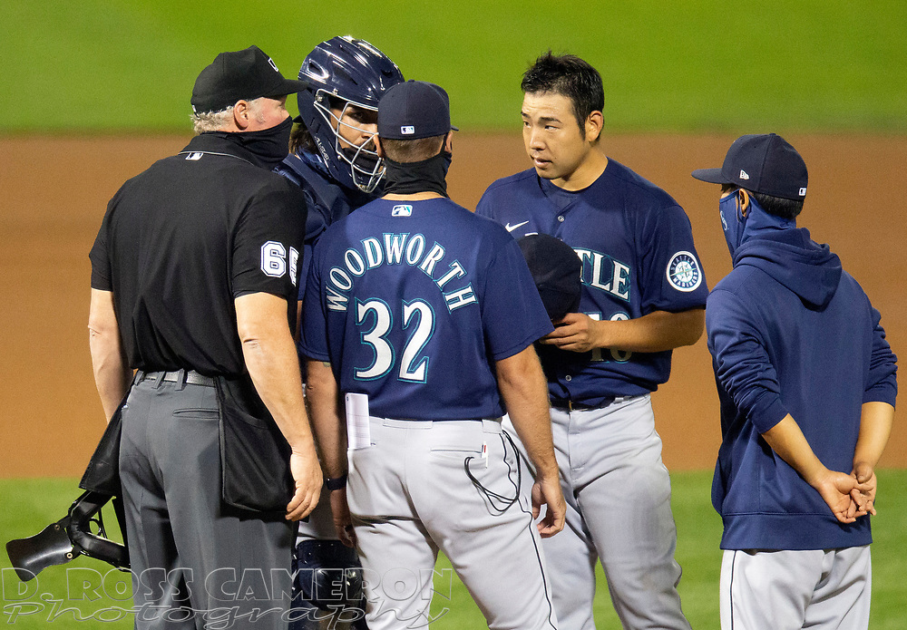 Sep 25, 2020; Oakland, California, USA; Seattle Mariners pitching coach Pete Woodworth (32) confers with starting pitcher Yusei Kikuchi (18) during the fourth inning of a Major League Baseball game against the Oakland Athletics at Oakland Coliseum. Umpire is Ted Barrett. Catcher is Joseph Odom. Man at right is unidentified translator. Mandatory Credit: D. Ross Cameron-USA TODAY Sports