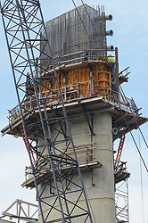 Tower, Crane, New Pearl Harbor Memorial Bridge under Construction at New Haven Harbor Crossing, Connectictut. CONNDOT Contract B, Project #92-618. When complete the alternately named Quinnipiac River Bridge will be first Extradosed Engineered & Designed Bridge in the United States.
