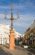 Elaborate street lighting in a city centre street, Ronda, Spain