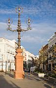 Elaborate street lighting in a city centre street, Ronda, Spain