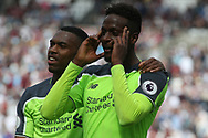 Divock Origi of Liverpool ® celebrates after scoring his teams fourth goal. Premier league match, West Ham Utd v Liverpool at the London Stadium, Queen Elizabeth Olympic Park in London on Sunday 14th May 2017.<br /> pic by Steffan Bowen, Andrew Orchard sports photography.