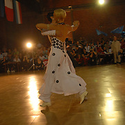 Petra Zimmermann, front, and Caroline Privou, rear, both of Cologne, Germany, compete in the adult women's standard A division of the same-sex ballroom dancing competition during the 2007 Eurogames at the Waagnatie hangar in Antwerp, Belgium on July 14, 2007. ..Over 3,000 LGBT athletes competed in 11 sports, including same-sex dance, during the 11th annual European gay sporting event. Same-sex ballroom is a growing sports that has been happening in Europe for over two decades.