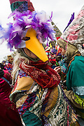Cajun Mardi Gras revelers dancing during the Faquetigue Courir de Mardi Gras chicken run on Fat Tuesday February 17, 2015 in Eunice, Louisiana. The traditional Cajun Mardi Gras involves costumed revelers competing to catch a live chicken as they move from house to house throughout the rural community.