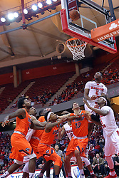 10 December 2016:  DJ Clayton(2) hangs in the air after launching a shot while 7 other players gather under the bucket looking for a rebound during an NCAA  mens basketball game between the UT Martin Skyhawks and the Illinois State Redbirds in a non-conference game at Redbird Arena, Normal IL