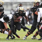 ORLANDO, FL - NOVEMBER 21:  Otis Anderson #2 of the Central Florida Knights runs the ball against the Cincinnati Bearcats at Bounce House-FBC Mortgage Field on November 21, 2020 in Orlando, Florida. (Photo by Alex Menendez/Getty Images) *** Local Caption *** Otis Anderson