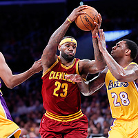 15 January 2015: Cleveland Cavaliers forward LeBron James (23) drives past Los Angeles Lakers forward Tarik Black (28) and Los Angeles Lakers forward Nick Young (0) during the Cleveland Cavaliers 109-102 victory over the Los Angeles Lakers, at the Staples Center, Los Angeles, California, USA.