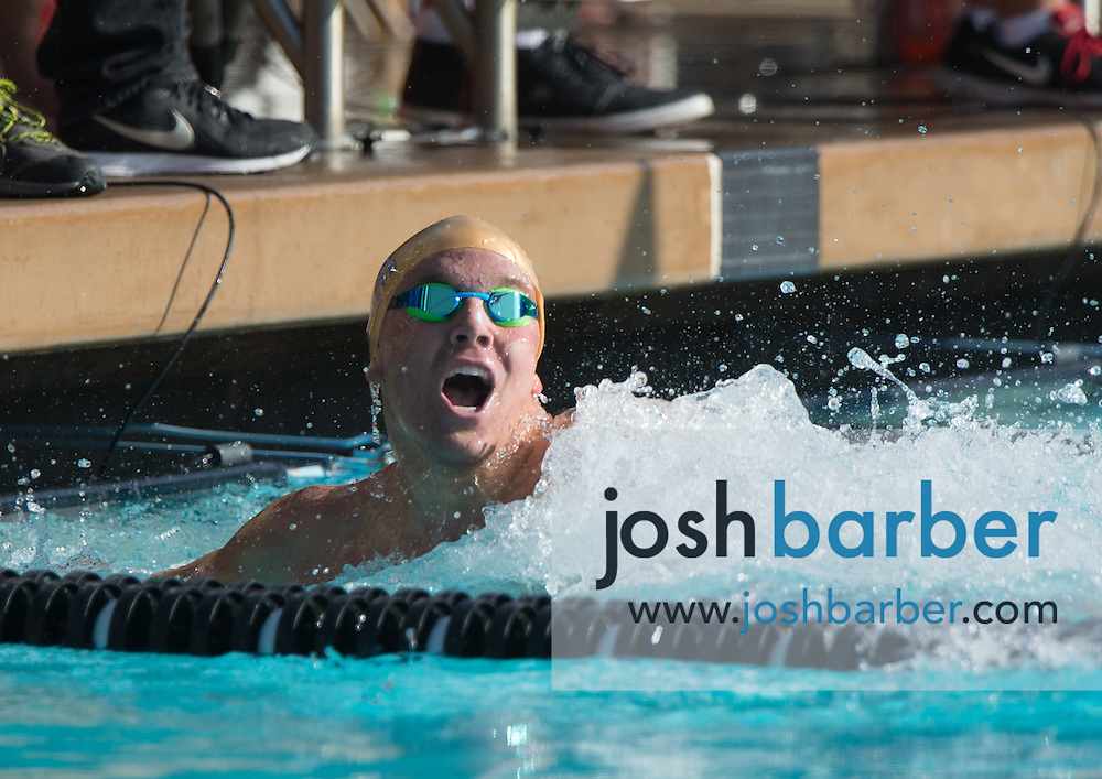 Santa Margarita's Grant Shoults celebrates after competing in the boys 200-yard freestyle during the CIF-SS Division 1 Swimming Finals at Riverside City College on Saturday. Shoults took first and set a national high school record of 1:33.26 in the event.