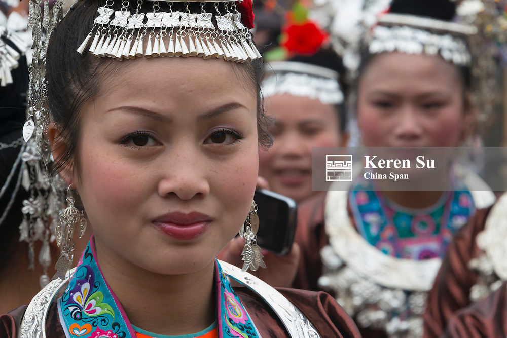Dong girls in traditional clothing celebrating March 3 Festival, Sanjiang, Guangxi Province, China