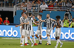 Juventus forward Gonzalo Higuain is congratulated by teammates after scoring against Paris Saint-Germain during the first half of an International Champions Cup match on Wednesday, July 26, 2017, at Hard Rock Stadium in Miami Gardens, Fla. Juventus won, 3-2. Photo by David Santiago/El Nuevo Herald/TNS/ABACAPRESS.COM