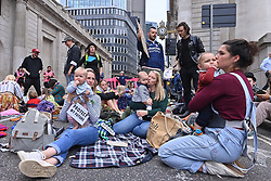 © Licensed to London News Pictures. 31/08/2021. London, UK. Families block the roads outside the BANK OF ENGLAND during EXTINCTION REBELLION'S THE IMPOSSIBLE REBELLION demonstration. Photo credit: Ray Tang/LNP