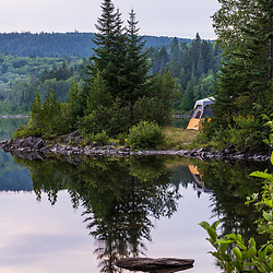 A tent on the shore of Pushineer Pond in Aroostook County, Maine. Deboullie Public Reserve Land.
