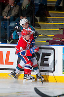 KELOWNA, CANADA - JANUARY 4: Keanu Yamamoto #9 of the Spokane Chiefs checks Conner Bruggen-Cate #20 of the Kelowna Rockets into the boards on January 4, 2017 at Prospera Place in Kelowna, British Columbia, Canada.  (Photo by Marissa Baecker/Shoot the Breeze)  *** Local Caption ***